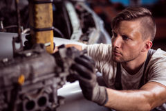 Hard working mechanic Stock Photo