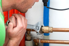 Hard working plumber Stock Images