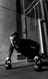 Hard working professional weightlifter doing push ups Stock Images