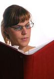 Hard Working Student!. A young woman is studying hard while reading in a book Stock Photos