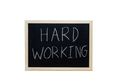 HARD WORKING written with white chalk on blackboard Stock Photo