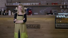 Hard working woman finally opens her own cafe business and stands proudly in front of the counter with arms crossed and smiling. Hard working young blonde woman stock video