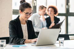 Hard-working young woman analyzing business information Royalty Free Stock Photos