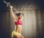 Hard workout with barbell Stock Photography