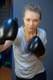 Hard workout in gym. Woman hard workout in gym Royalty Free Stock Images