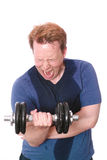 Hard workout. Young man screaming during a biceps curl, for your workout or sports injury concepts - isolated on white Royalty Free Stock Photo