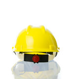 Hard yellow hat for industrial work, engineers, architect isolat Stock Image