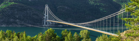 Hardanger Bridge. Norwegian: Hardangerbrua is a suspension bridge across the Hardangerfjorden in Hordaland county, Norway. The bridge connects the Stock Photo
