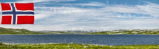 Hardanger landscape in Norway with flag. Hardanger landscape in Norway with Norwegian flag royalty free stock image