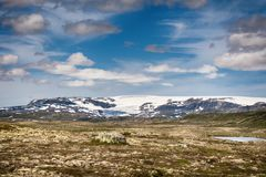 Hardangerjokulen glacier on top of Hardangervidda plateau. Royalty Free Stock Photo