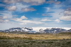 Hardangerjokulen glacier on top of Hardangervidda plateau. Royalty Free Stock Photos