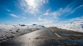 Hardangervidda. A road over mountain passing at winter in Norway Royalty Free Stock Photos