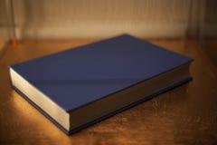 Blue Hardback book. Hardback blue book in soft lighting stock image