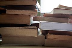 Tow stacks of paperback and hardback books stock photo