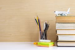 Hardback or textbook stacked and stationary placed on the table. The concept of intelligence comes from education. Selective focused Stock Photo