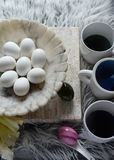 8 hardboiled eggs on marble bowl. White easter eggs waiting to be dyed on white marble bowl Stock Image