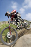 Hardcore. Downhill mountain biker racer Royalty Free Stock Photos