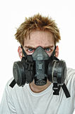 Hardcore Gasmask. A young man wearing a protective gas mask. Harsh hardcore grunge contrast and tonemapping Stock Photography