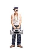 Hardcore rapper holding a ghetto blaster Stock Photo