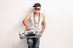 Hardcore senior rapper holding a ghetto blaster Stock Photography