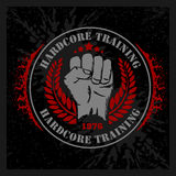 Hardcore training - Fist and wreath vintage label Royalty Free Stock Photography