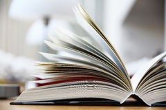 Hardcover book lying on the table in the library Stock Photo