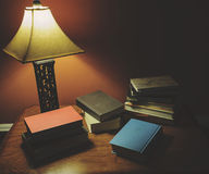 Hardcover Books Laying On Wood Table With Lamp Shinning Royalty Free Stock Photography