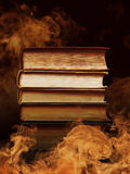 Hardcover books with swirling smoke Stock Photo