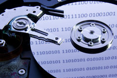 Harddisk. Internals of harddisk with binary digit reflections Stock Photography