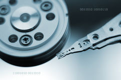 Harddisk. The insides of a harddisk with0011010 text added Royalty Free Stock Photography