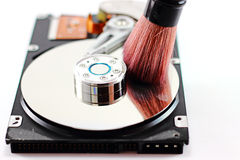 Harddisk and Cleaning brush Stock Photo
