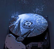 Harddisk with fiber optical background Stock Photos