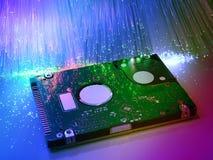 Harddisk med optisk bakgrund för fiber Arkivfoto