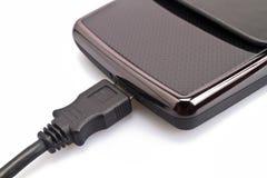 Harddisk och USB-kabelClose upp Arkivbild