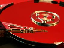 Harddisk red. Harddisk closeup with red reflection Stock Photos