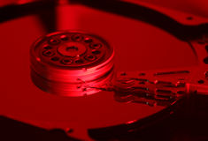 Harddrive. Open computer hard disk in red light Stock Photography