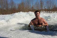 Hardening in the ice-hole. Russia. Tomsk. Tomsk Club Walrus. Man in the ice-hole Royalty Free Stock Images