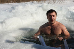 Hardening in the ice-hole. Russia. Tomsk. Tomsk Club Walrus. Man in the ice-hole Stock Photography
