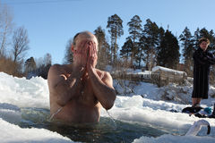 Hardening in the ice-hole. Russia. Tomsk. Tomsk Club Walrus. Man in the ice-hole Royalty Free Stock Photo