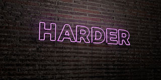 HARDER -Realistic Neon Sign on Brick Wall background - 3D rendered royalty free stock image Stock Photography