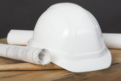 Hardhat and blueprints Royalty Free Stock Images