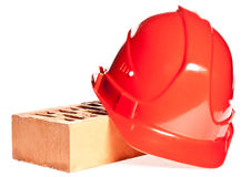 Hardhat and a brick Stock Photo