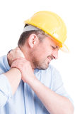 Hardhat builder or architect back neck pain concept Royalty Free Stock Photo