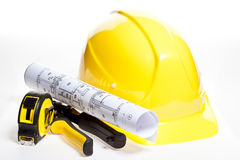 Hardhat, construction tools and blueprint Royalty Free Stock Images