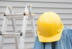 Hardhat And Denim Royalty Free Stock Image