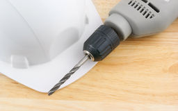 Hardhat and drill Royalty Free Stock Photo