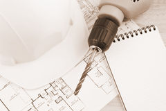 Hardhat, drill and note pad Royalty Free Stock Photography