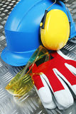 Hardhat, earmuffs, glasses and gloves Royalty Free Stock Photography