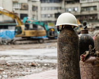 Hardhat on a gas cylinder at a construction site Royalty Free Stock Photography