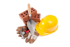 Hardhat, Glove, Brick and trowel Royalty Free Stock Photography
